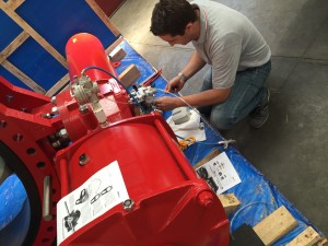 valves package - valveIT staff installing positioner on valves.